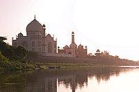 The Taj Mahal, UNESCO World Heritage Site, at sunset reflected in the Yamuna River, Agra, Uttar Pradesh, India, Asia