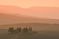 Dawn at Penella, a farmhouse surrounded by cypress trees and the misty hills of Val d'Orcia near Pienza, UNESCO World Heritage Site, Tuscany, Italy, Europe