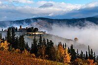 Castello di Colognole as sun breaks through early morning mist, Greve in Chianti, Tuscany, Italy, Europe