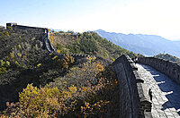 View along the Great Wall of China, Mutianyu section, UNESCO World Heritage Site, trees in autumn colours, Beijing, China, Asia