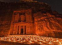Candles in front of the Pharaoh's treasure house, struck in rock, at night, facade of the treasure house Al-Khazneh, Khazne Faraun, mausoleum in the Nabataean city Petra, near Wadi Musa, Jordan, Asia
