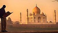 Silhouette of a man reading a newspaper, Taj Mahal monument, Agra, India, Asia