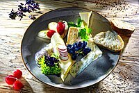 Cheese platter, various cheeses served with grapes