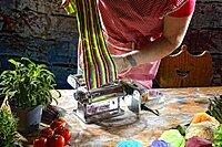 Pasta machine with fresh coloured pasta dough, Germany, Europe