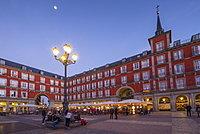 View of restaurants in Plaza Mayor at dusk, Madrid, Spain, Europe