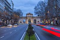 View of Triomphal Arch (Puerta de Alcala) in Plaza de la Independencia at dusk, Madrid, Spain, Europe