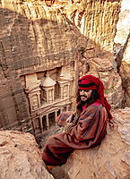 Bedouin man at The Treasury view point, Petra The Monastery (Ad-Deir), Petra, UNESCO World Heritage Site, Ma'an Governorate, Jordan, Middle East