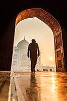 Sun rises behind the Taj Mahal as a man walks in, UNESCO World Heritage Site, Agra, Uttar Pradesh, India, Asia