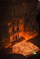 Candles in front of the Pharaoh's treasure house, struck in rock, at night, view from above into the gorge, facade of the treasure house Al-Khazneh, Khazne Faraun, mausoleum in the Nabataean city of Petra, near Wadi Musa, Jordan, Asia