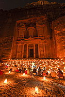 People sitting in front of candles, Pharaoh's treasure house beaten into rock at night, facade of the treasure house Al-Khazneh, Khazne Faraun, mausoleum in the Nabataean city of Petra, near Wadi Musa, Jordan, Asia
