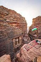 View from above into the gorge Siq, Pharaoh's treasure house carved into rock, facade of the treasure house Al-Khazneh, Khazne Faraun, mausoleum in the Nabataean city Petra with Jordanian flag, near Wadi Musa, Jordan, Asia