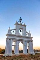 Bell tower of the chapel Ermita Reina de los Angeles, at sunset, Alajar, Huelva, Spain, Europe
