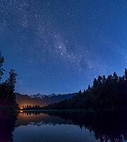 View of Mount Cook and Mount Tasman with starry sky and Milky Way, reflection in Lake Matheson, Westland National Park, New Zealand Alps, West Coast Region, South Island, New Zealand, Oceania