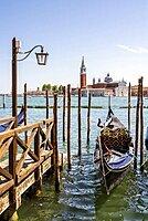 Venetian gondola in the lagoon, monastery San Giorgio Maggiore, district San Marco, Venice, region Veneto, Italy, Europe