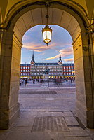 View of Casa de la Panaderia in Plaza Mayor through archway at dusk, Madrid, Spain, Europe