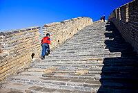 Chinese boy walking the Great Wall of China at Mutianyu, north of Beijing (formerly Peking)
