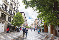 People on pedestrian street walking towards Plaza de la Puerta del Sol, Madrid, Spain, Europe