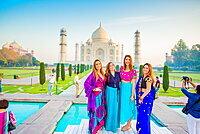 Tourists in saris standing in front of the Taj Mahal, UNESCO World Heritage Site, Agra, Uttar Pradesh, India, Asia