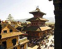 Nepal, Bhaktapur, Taumadhi Square View through pillars of temple of goddess Siddhi Laxmi.