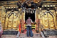 Man praying at Changunarayan Hindu temple, Kathmandu Valley, Nepal