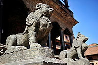 Statues in stone on the entrance of Hindu temple, Durbar Square, Patan, Nepal