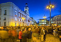View of Real Casa de Correos and Easter Parade in Puerta del Sol at dusk, Madrid, Spain, Europe