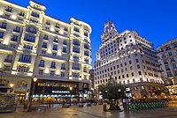 View of architecture illuminated on Gran Via at dusk, Madrid, Spain, Europe