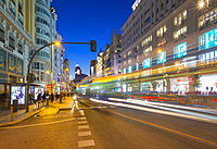 View of architecture and trail lights on Gran Via at dusk, Madrid, Spain, Europe