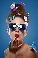Glamour shot of girl with butterflies on a blue background, Toronto, Ontario, Canada