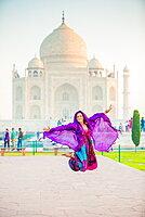 Laura Grier jumping at the Taj Mahal, UNESCO World Heritage Site, Agra, Uttar Pradesh, India, Asia
