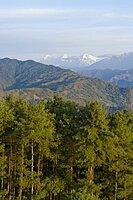 Nepal, Nagarkot, View across clouded Kathmandu valley towards Himalayan mountains