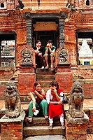 Young people sitting at Hindu temple, Durbar Square, Patan, Nepal