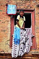 Child looking at a window, Panauti, valley of Kathmandu, Nepal