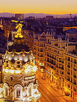 Metropolis Building with town, elevated view, at dusk, Madrid, Spain, Europe