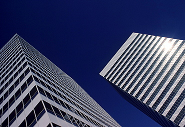 Two buildings cut into the downtown Los Angeles skyline.