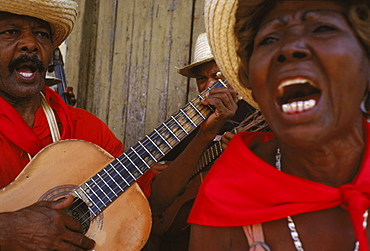 A musical troupe sing to passers-by to celebrate Carnaval in Santiago de Cuba.