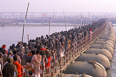 Naked sadhus return to their camps along the Ganges river after having taken a holy and purifying dip during the maha Kumbh mela in Allahabad India.