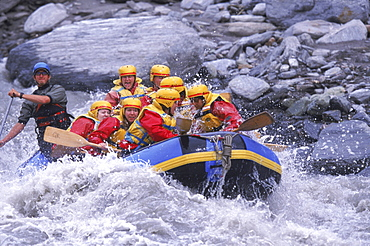Rafters make their way through Class IV rapids outside of Queenstown on the South Island of New Zealand.