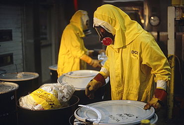 Men removing low level nuclear waste.