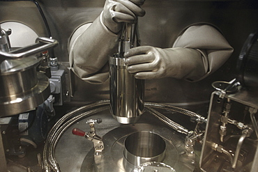 Handling nuclear material.