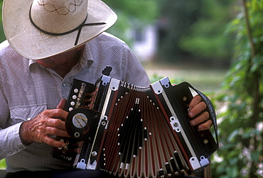 Musician performs in park, St. Martinville, Louisiana