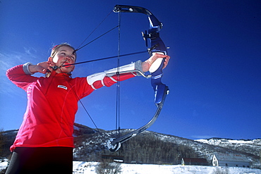 A Young participant in the relatively new sport of Ski Archery, a sport similar to biatholon but with archery instead of rifles, takes aim on a course in Park City, Utah