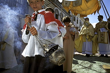 Swinging an incensor, a young altar boy makes way for a local priest carrying the Holy Eucharist during Easter Sunday's procession in Ouro Preto, Brazil.