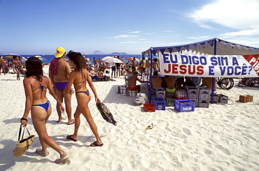 "I say yes to Jesus. And you? asks a banner on Rio de Janeiro's famous Ipanema beach. Known worldwide as a sun-drenched capital of flesh, Rio, where five new evangelical churches open every week, is ""the center of the Pentecostal earthquake."" This image is part of a five-part series on the rise of evangelical Protestantism in Latin America."