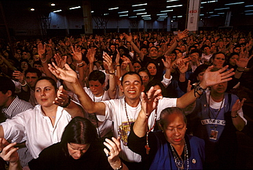 Worshippers at a service by Brazil's charismatic Padre Marcelo Rossi are encouraged to sing, shout and speak in tongues much like their Pentecostal counterparts, yet Catholic traditions, such as communion are preserved. This image is part of a five-part series on the rise of evangelical Protestantism in Latin America.