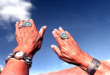 """Project Howl of Freedom 1 of 10. There is an old Indian Proverb which says: """"Land is People, Remembering is All"""" Etched upon Navajo Etta Abriso's timims a history of the native american people. Proud are worn hands is a history of the proud and worn lives of the Native American people. The people of the Southwest weave a rich mosaic of culture, tradition and ritual within the mountain boundaries of the desert. These pueblo indians, anglo ranchers, Mexican tradesman and artistic pioneers cling to their land and in turn, their individualism. However, in a homogenizing society that is rapidly expanding in numbers, technology and laws, these descendants of Spanish Conquistadors and Native Americans are slowly being robbed of their identities."""