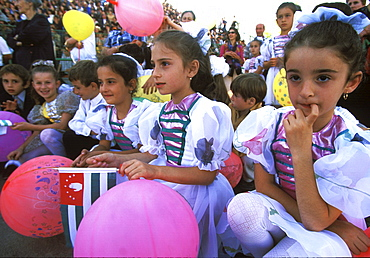 "Young girls with Abkhaz flags wait for their turn to perform during a gala show at the main stadium in Sukhumi, celebrating ten years of ""independence"" from Georgia, and the ten year anniversary of the end of the war, in Sukhum, Abkhazia."