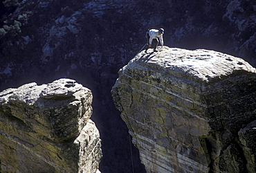 A rock climber in the Windy Point area of the Santa Catalina Mountains, north of Tucson, Arizona