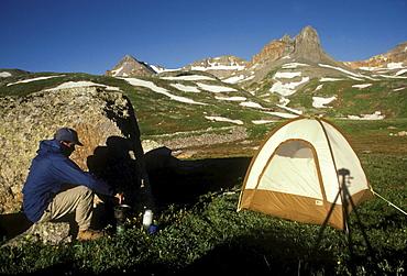 A backpacker in Ice Lake Basin near Silverton in the San Juan Mountains of southwestern Colorado