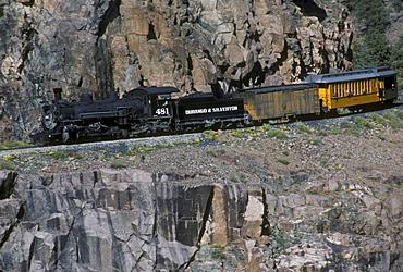 Coal-fired, steam-powered locomotive of the Durango & Silverton Narrow Gauge Railroad on the tracks between Silverton and Durango, Colorado